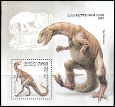Dinosaurs on stamps-like labels of Tuva region of Russia
