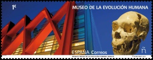 Museum of Human Evolution in Burgos and skull of Homo heidelbergensis or an early Neanderthal man on stamp of Spain 2020
