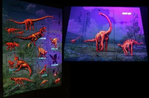 Dinosaurs on stamps of China 2017 stamps under UV light