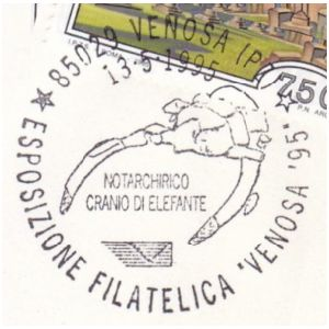 Tusks and skull of prehistoric elephant on postmark of Italy 1995