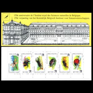 Iguanodon on reverse side of The 150th Anniversary of the Institute of Science booklet of stamps of Belgium 1996