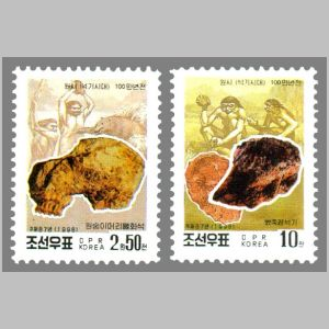 stone tools and hominids on Korean Central History Museum stamps of North Korea 1998