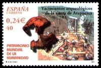 paleoanthropological excavation at Atapuerca and a skull of Homo erectus on stamp of Spain 2001
